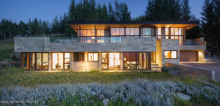 Built of concrete, glass and Kota stone imported from India, this low-slung, ultra-modern home calls to mind Frank Lloyd Wright, but with more modern materials and technology.