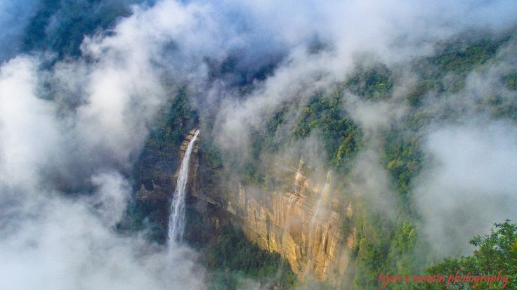 Nohkalikai Falls is the tallest waterfall in India. Its height is 1100 feet (335 metres).The waterfall is located near Cherrapunji, one of the wettest places on Earth. It is also the fourth largest waterfall in the world. Nohkalikai Falls are fed by the rainwater collected on the summit of comparatively small plateau and decrease in power during the dry season in December - February. Below the falls there has formed a plunge pool with unusual green colored water.