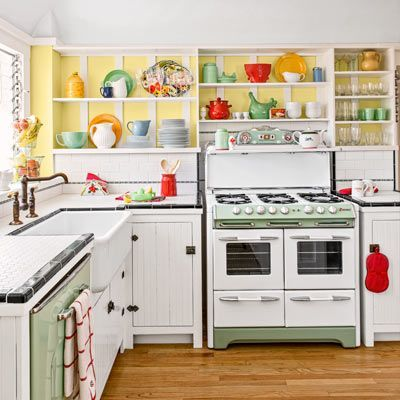 The star of the show in this kitchen is a 1950s O'Keefe & Merritt stove, refinished to match a vintage-green dishwasher and flanked by cabinets with salvaged-beadboard doors. | Photo: Ray Kachatorian