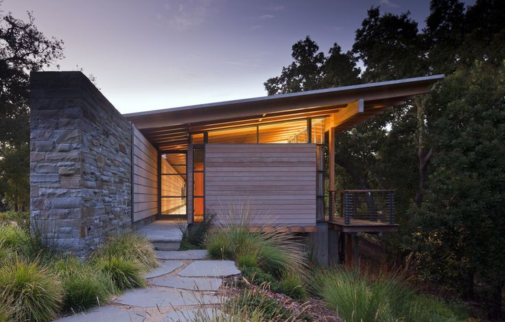 This guest house is the first of three structures to be built alongside a winding lane atop a ridge in the Santa Lucia Preserve, positioned five miles inland from the Pacific Ocean.