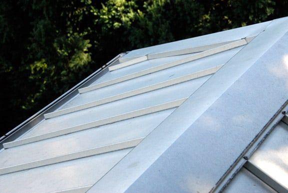 Pros Cons Of Metal Roofing Hometips In 2020 Roofing Metal Roof Sheet Metal Roofing