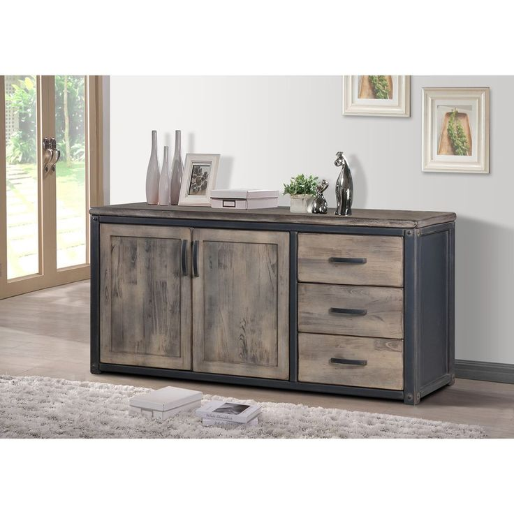 Dress up your living room with this rustic-inspired Heritage Buffet, featuring a weathered washed grey finish. This Heritage piece also offers two doors and three drawer making it an ideal piece for your contemporary home.