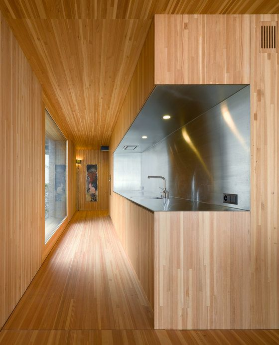Kitchen as cut out from massive wooden interior.  inside the Huse holiday house by Lischer Partner Architekten.