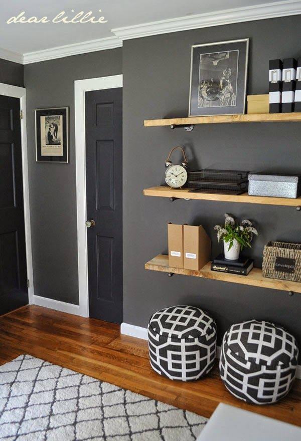Great colors and shelving for a guy's room. Benjamin Moore Kendall Charcoal on the walls, trim is BM Simply White, Target rug, DIY wood plank shelves, poufs from Target