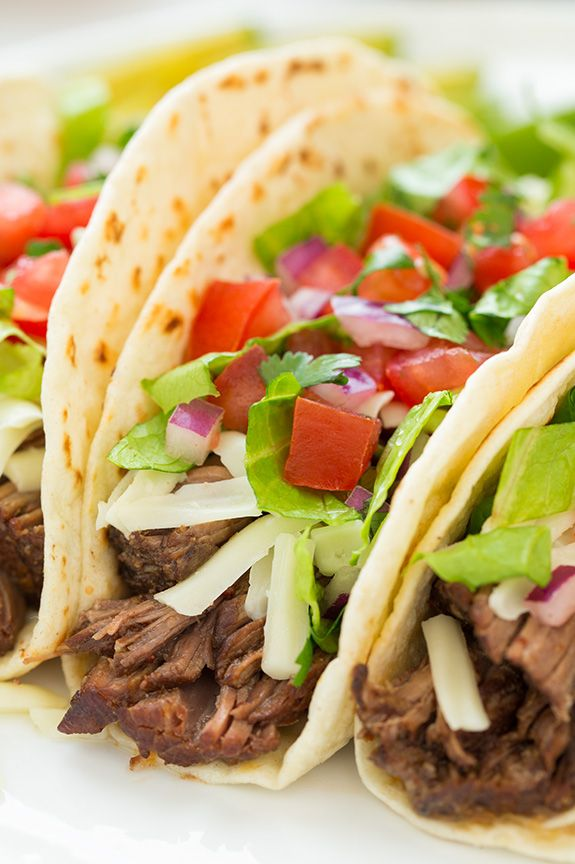 Slow Cooker Barbacoa Beef Tacos (Chipotle Copycat) - these are unbelievably delicious! My husband said they're his new favorite tacos!
