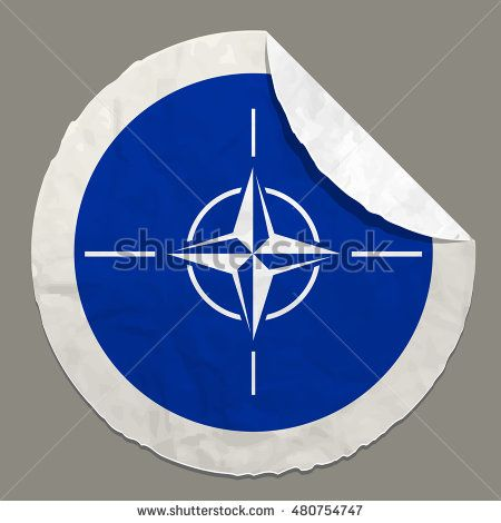 NATO flag symbol on a paper label