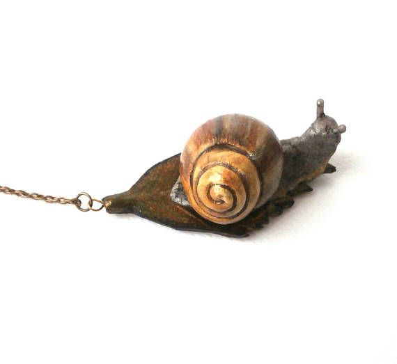 Gold snail on leaf polymer clay pendant by Lijoux