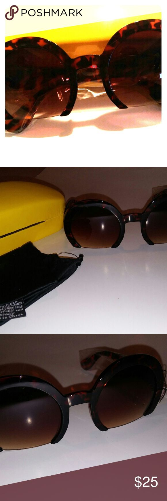 Sunglasses Fashion forward trending style.  Animal print half lens sunglasses.  Up to 100% UVB & UVA protection. Comes with case and pouch for protection.  Case color may vary. Pouch works as lens cleaner. Accessories Glasses