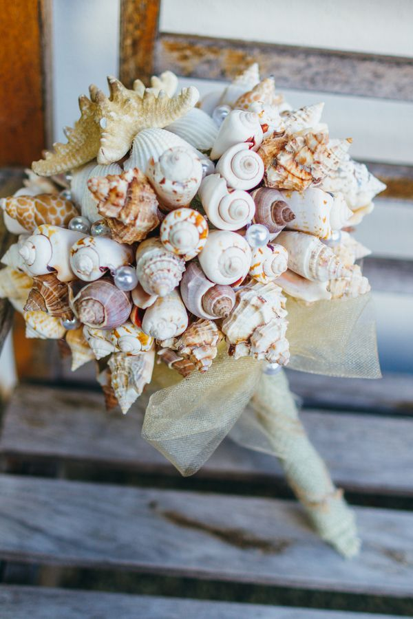 Come see some sexy barefoot sandals and a groom-made bouquet at this Oahu wedding