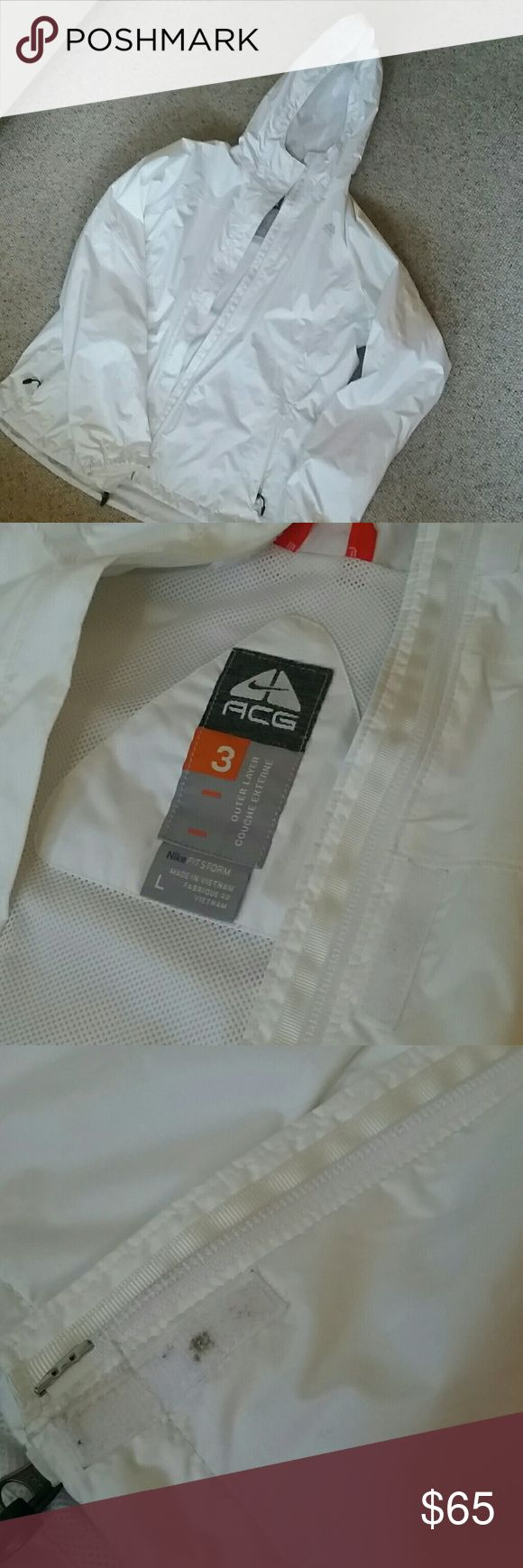 Nike Fitstorm raincoat with hood White jacket in great condition! Only worn a few times, it's just too big for me. There is a little bit of dirt trapped in the velcro and a bit of barely noticable staining around the wrists, both as shown. Offers welcome :) Nike Jackets & Coats