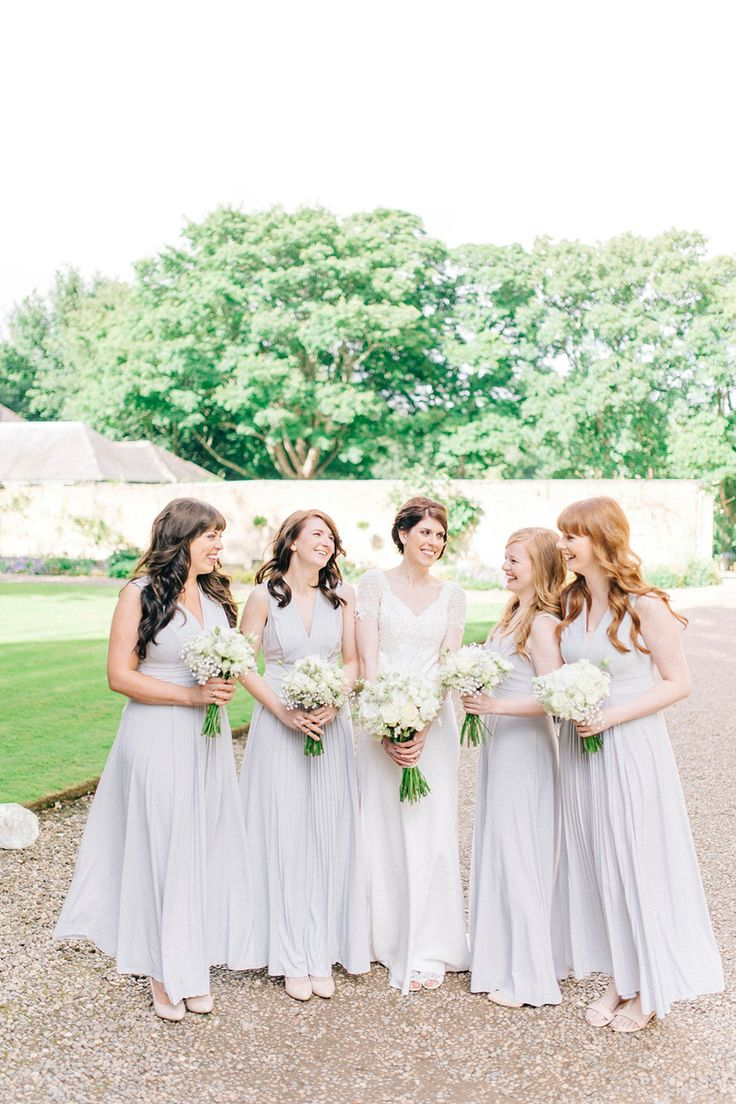 Bridesmaids wear pale grey dresses  | Photography by http://sarahjaneethan.co.uk/