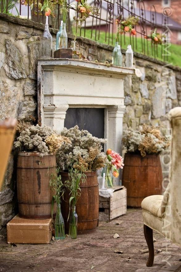 Barrels AND a mantel!!! And antique bottles! We MUST find Wine barrels!  #barrels #wedding #mantle #weddingalter