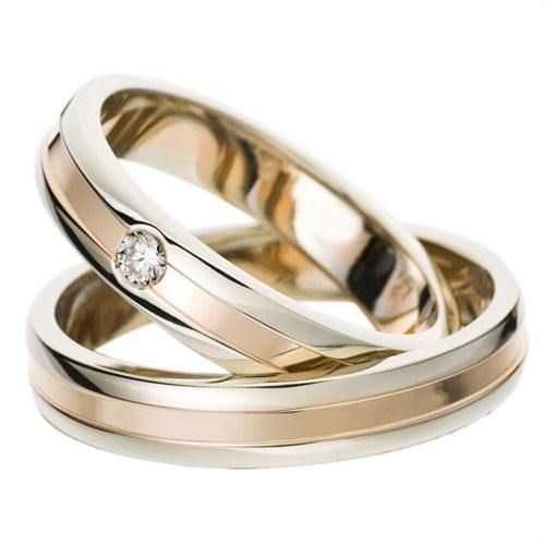 Trauringe Gold: Hochwertige Eheringe der Firma Rauschmayer aus Weißgold und Rotgold. Die Ringe stammen aus der Kollektion Elements. Sie sind 4mm breit und besitzen eine glänzende Oberfläche. Der Damenring wird von einem Brillanten geziert. Das Angebot umfaßt beide Eheringe und eine kostenlose Innengravur: Sie haben die Wahl zwischen einer Diamantgravur oder einer Lasergravur. Zudem erhalten Sie ein Gratis-Etui. Die Ringe können auch als Verlobungsringe, Partnerringe oder Freundschaftsringe…