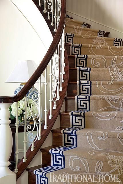 Arkansas Home with a Stylish Palette | Traditional Home | Greek Key design border for carpeted stair runner!  sand with white and navy. Gorgeous staircase bannister & spindles!