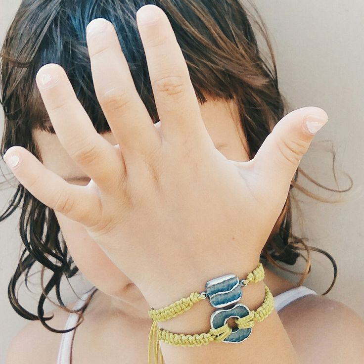 She wants to show us these silver bracelets.