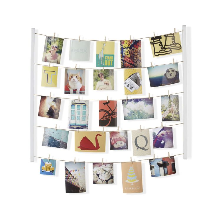 Like Pinterest, but in real life, this photo collage setup takes your favorite pictures and images and brings them together for a single unified, stunning display. Forty clips across five lines offer y... Find the Clippy Collage Photo Display, as seen in the Playful Modern Loft in Brooklyn Collection at http://dotandbo.com/collections/playful-modern-loft-in-brooklyn?utm_source=pinterest&utm_medium=organic&db_sku=UMB0178