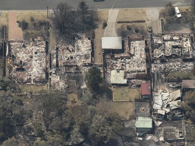 An aerial picture in the Springwood, Winmalee area showing burnt houses and properties.