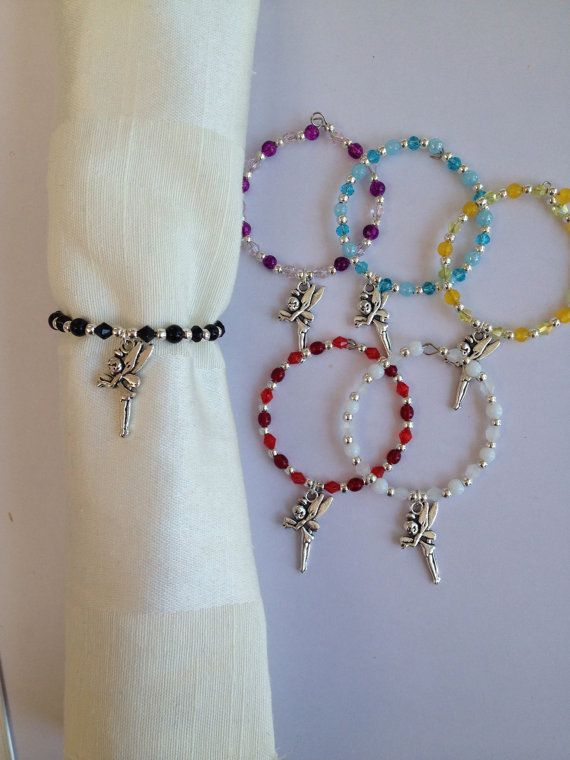 Beaded Napkin Rings with Silver Fairy Charm Set by DianaSianCrafts, £10.00