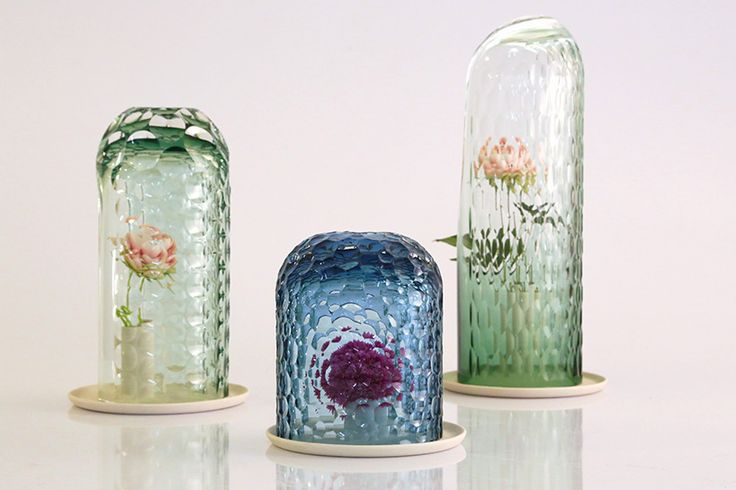 Wow, would I like a set of these! OP-vase by bilge nur saltik multiplies + reflects flower formations