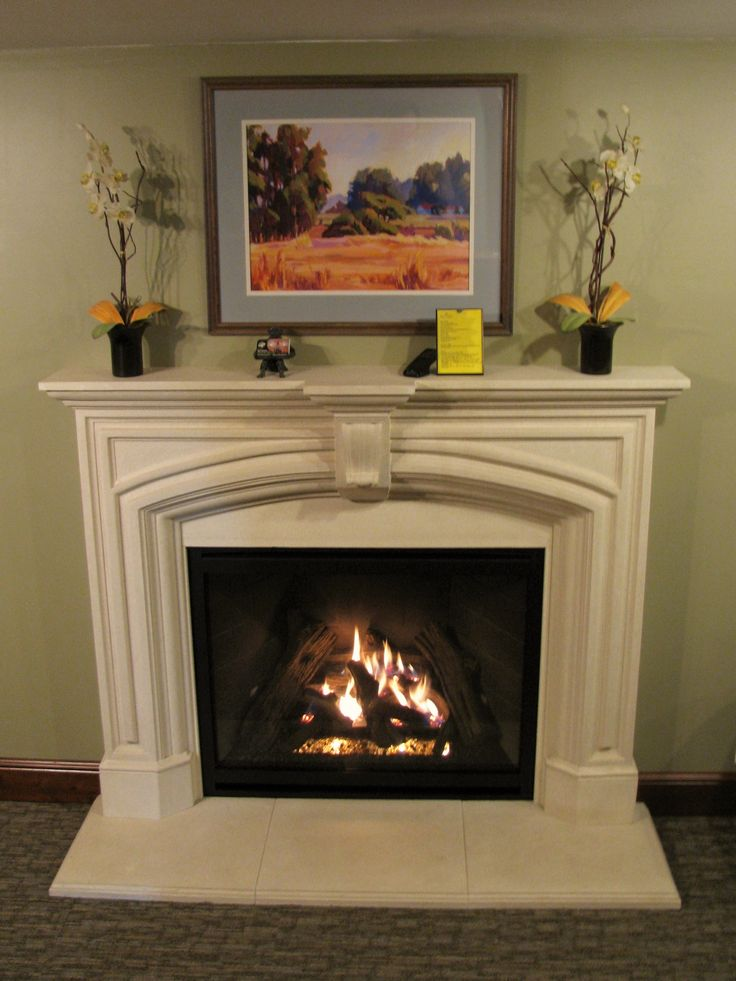 "From our showroom...Kozy Heat ""Carlton"" gas fireplace with Dracme ""Elizabeth"" cast stone surround."