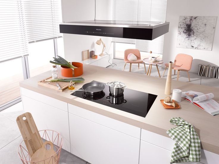 Open planning living is an ideal situation for small apartments, allowing you to make best use of limited space. Seen here is the Miele KM6389 Induction Hob - find out more about making the decision between gas and induction cooking on our blog, Der Kern #kitchendesign