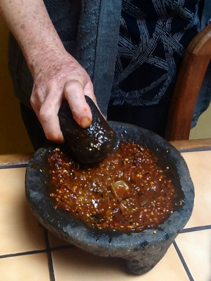 Salsa Roja en Molcajete....  5-6 medium tomatillos, roasted 7-10 chile de arbol (spicy=more chiles/mild=less chiles), roasted 1 clove garlic, roasted ~ 1/2 tsp water Salt to taste
