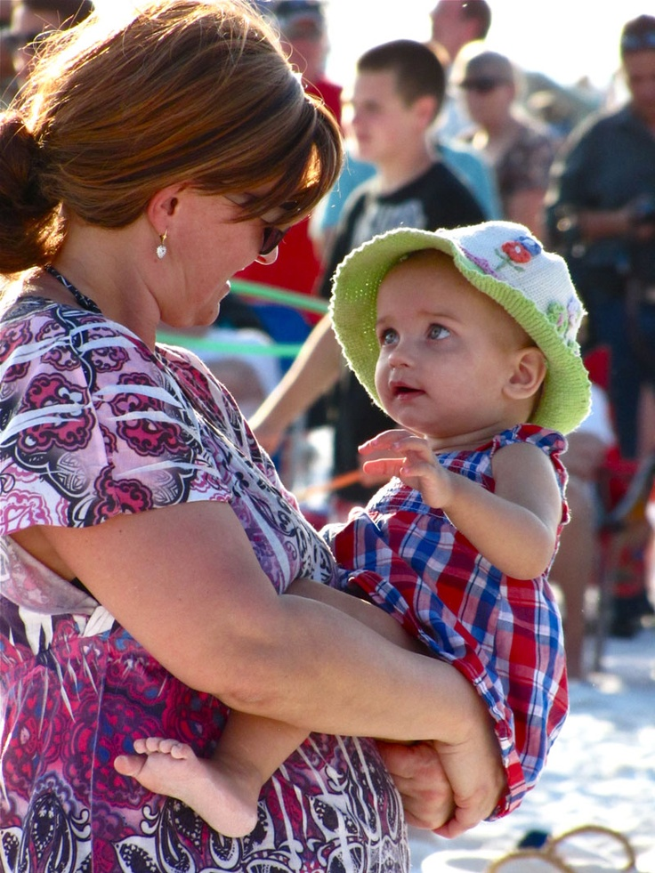 I took this photo at Siesta Key Beach 2013. Just love the adoration this little one is showing to her mom (?)