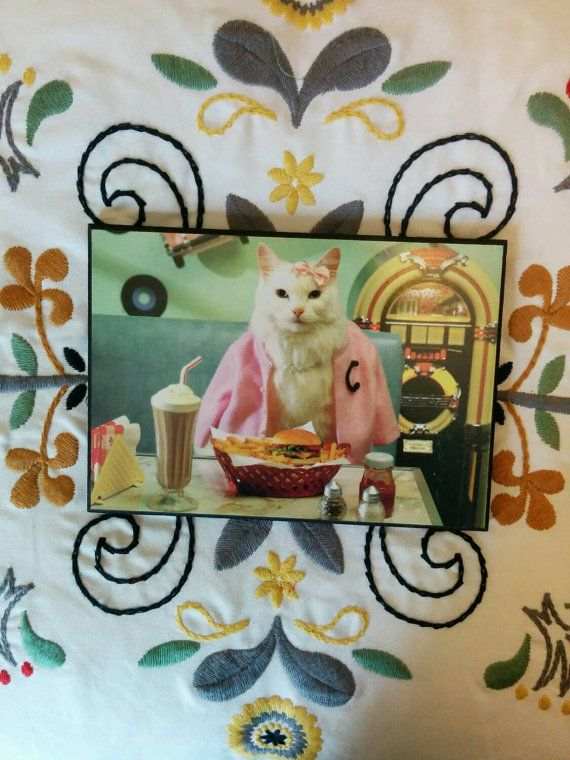 Check out this item in my Etsy shop https://www.etsy.com/listing/227041397/cat-eating-a-burger-pop-shoppe-1950s-cat
