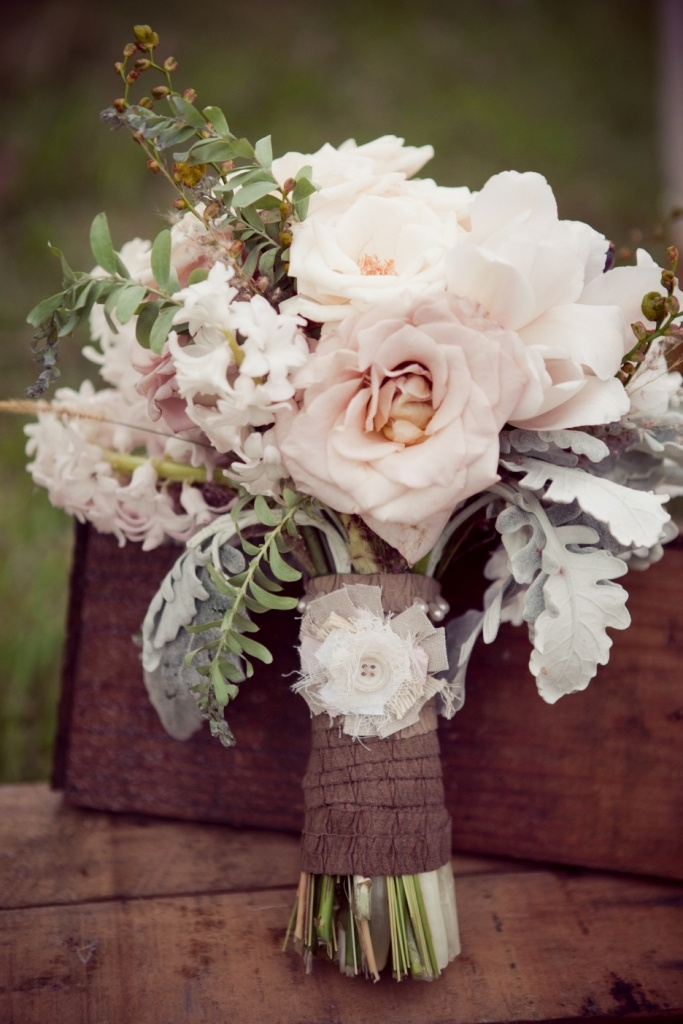 .I like the look of the bouquets being wrapped like this. Burlap or twine would also be cute.