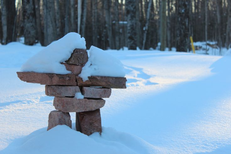 Inuksuk at the cottage. We have a collection of inuksuit (the plural of inuksuk) around the cottage as friendly guardian spirits. Each is built of local rocks: feldspar, rose quartz, schist, granite. They look lovely in summer, but in winter they seem much more in their element...
