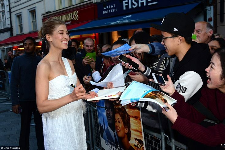 Fan favourite: The Gone Girl actress proved a popular draw with fans, who lined up to get ...