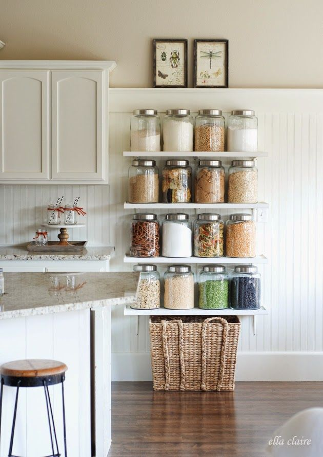 This kitchen storage idea looks great! Keep from mixing up flour, sugar, salt, and more by using a Go Dry Erase marker to discreetly label each jar. If you decide to change them out later you can just wipe it away!