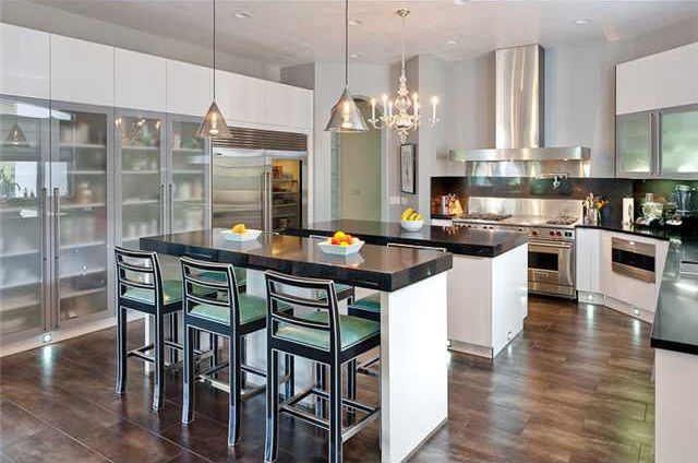 large kitchen? Use two bar top islands to help with the traffic flow