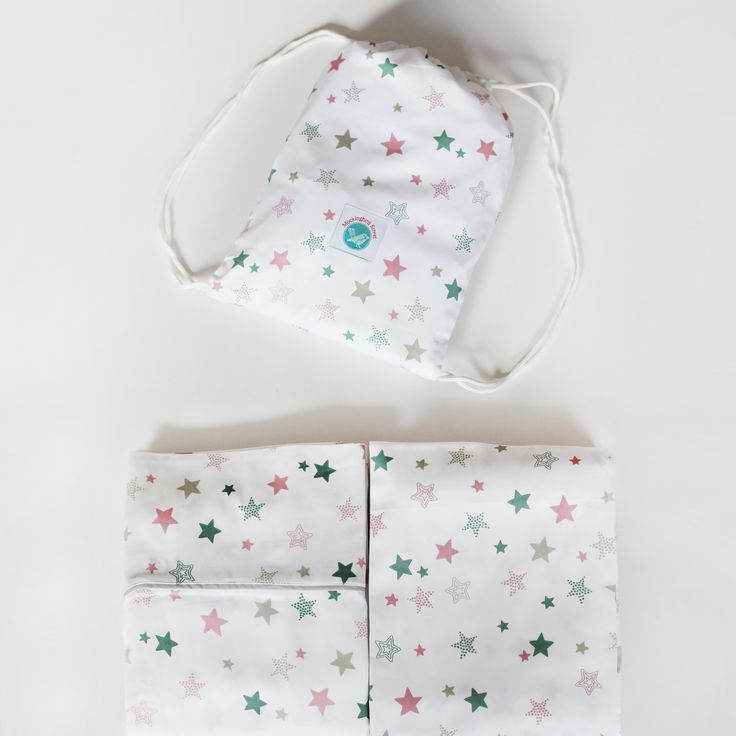Starlight cot sheet set fits both standard and boori cots, 100& organic cotton. Comes with reusable bag.
