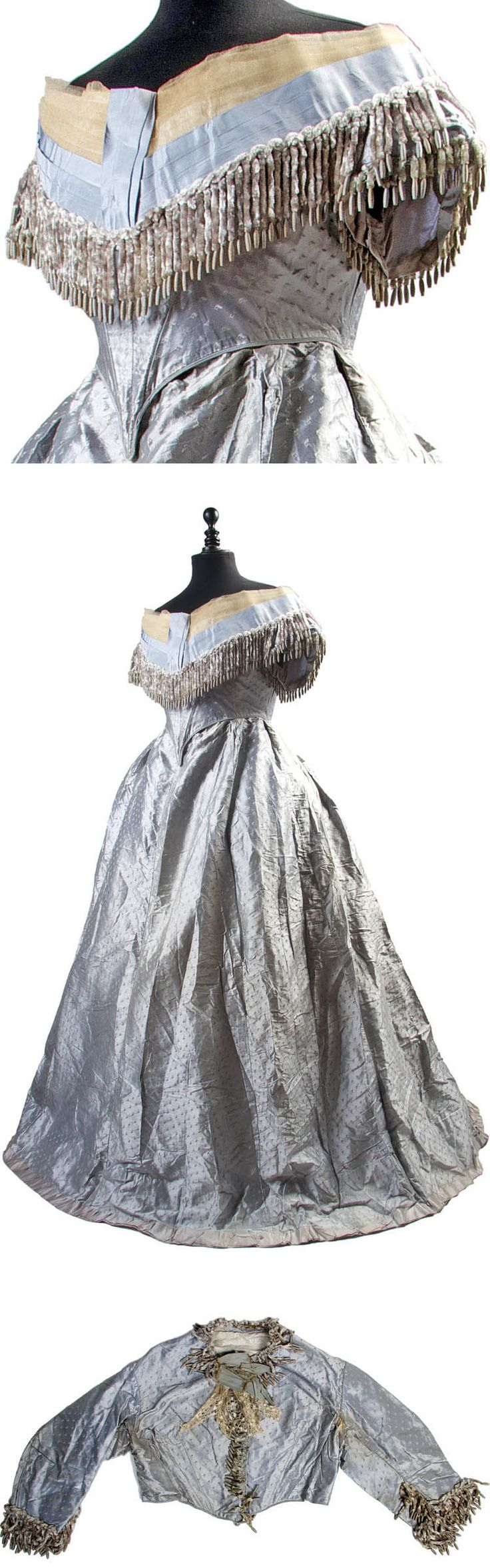 Three-piece dress ca. 1860s. Ice blue damask silk with day bodice, evening bodice, & skirt. Day bodice has long sleeves and high rounded neckline & is trimmed with chenille fringe. Evening bodice has short, capped sleeves, wide neckline, and deeply pointed bodice and includes detached silk and net bertha trimmed with chenille. Full skirt trimmed with satin ribbon at hem. Bonham's
