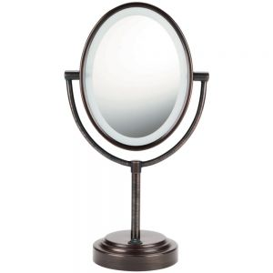 "Conair Double-sided Lighted Mirror (oiled Bronze). Oval Oiled-Bronze Double-Sided Illuminated Mirror... Double-sided Lighted Mirror with Elegant 7"" x 9.5"" Oval Design; Rotates 360 degrees for regular viewing or 7x Magnification; Oiled-bronze Finish; On/Off Power Switch; Picture Perfect Reflection Glass; Soft Halo Lighting for Clear Fog-free Viewing; 5 foot Line Cord; UL listed.Oval Double Sized Illuminated Mirror 7"" X 9.5"" Oval Design Rotates 360 For Regular Viewing Or 7x Magnification On…"