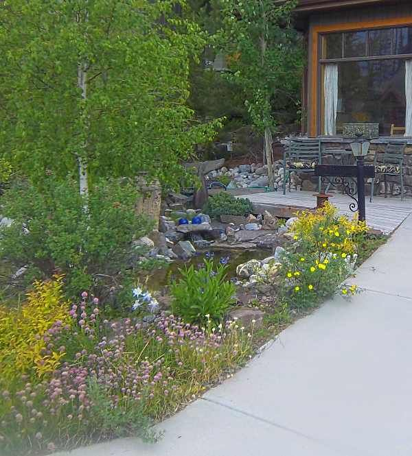 A small front yard water feature is enjoyed from this for Front garden feature ideas