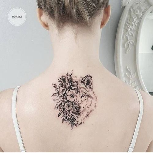 Flower wolf tattoo on the upper back. By Zlata Kolomoyskaya ...