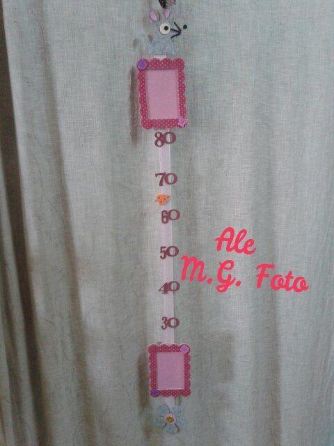 Segna altezza con porta foto,  marks height door photo