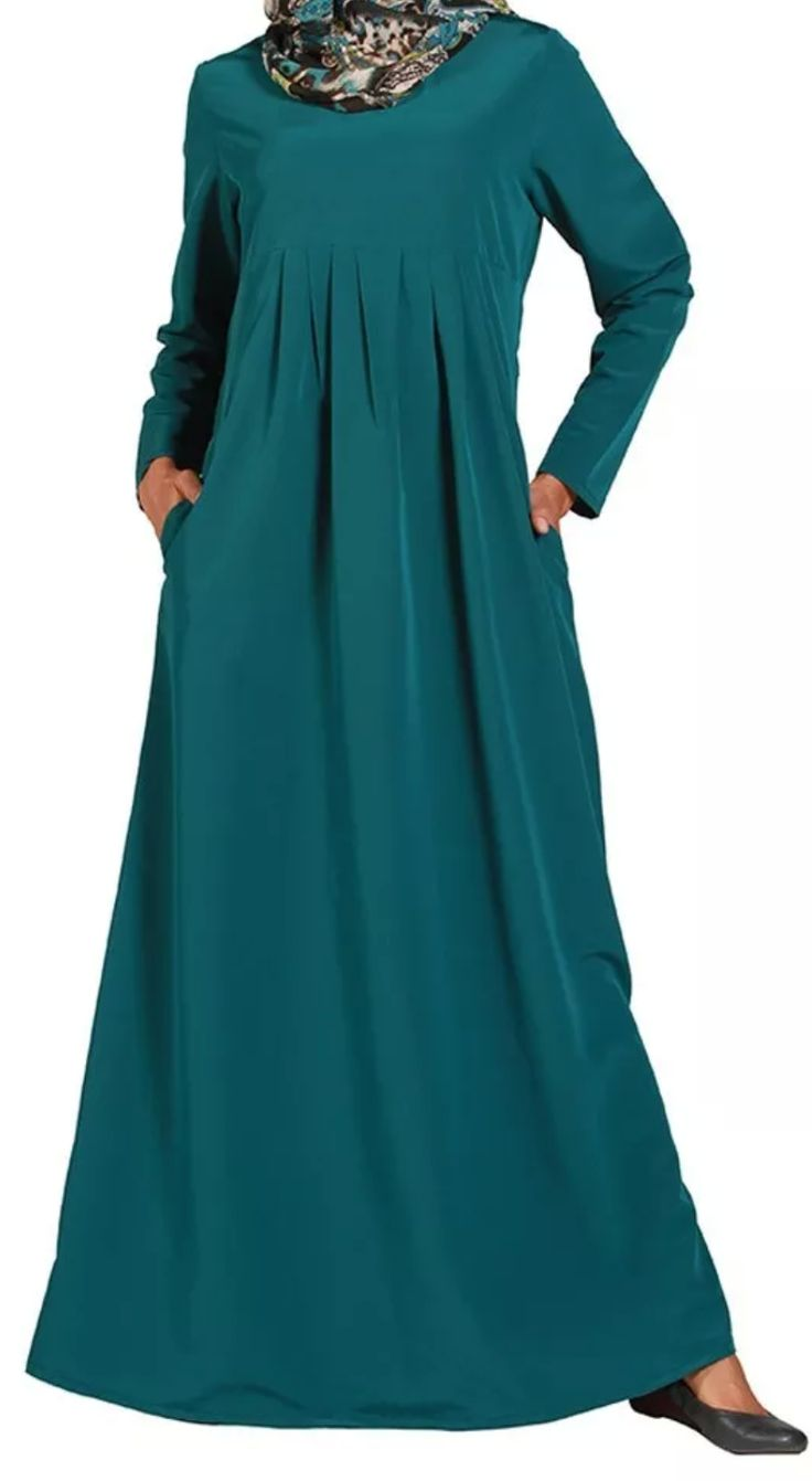 Available Size: XL Material: polyester Color : teal green Has hidden pockets on both sides. Great for the summer.