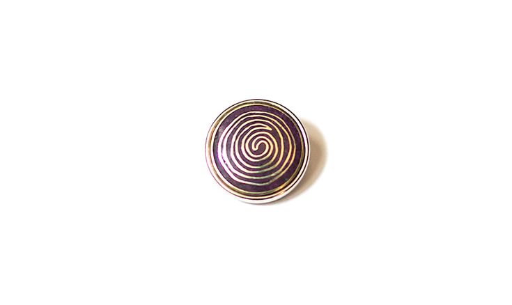 This Mila + Ruby pebble features the Aboriginal symbol of a Campsite or Meeting Place, meaning 'Together'.  Made from purple and gold metal with deco colouring.  Individually handcrafed in Nepal.