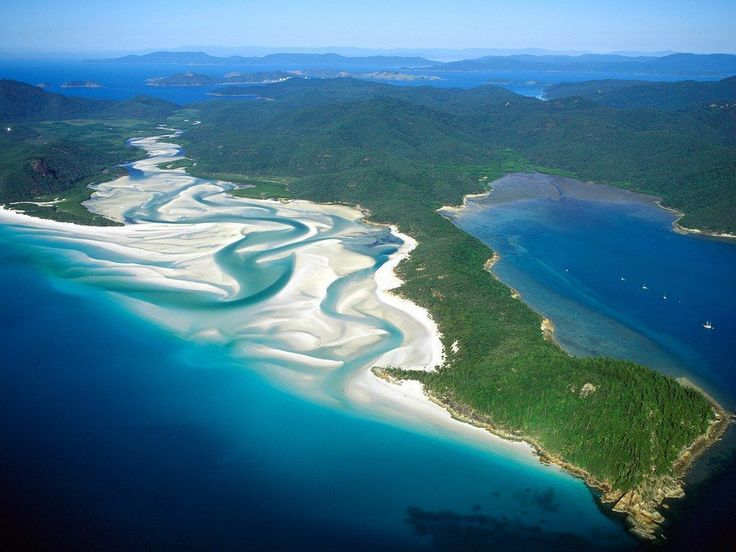 Considered by many to be Australia's most beautiful beach, four mile-long Whitehaven Beach off the coast of Queensland is appropriately named. It has the purest sand in the world—98 percent pure silica, so white it looks like baby powder—beautifully juxtaposed against azure waters. Active travelers will appreciate the beach's many coves and inlets, perfect for exploration, and snorkeling at the south end. #AustraliaTravelLongFlights