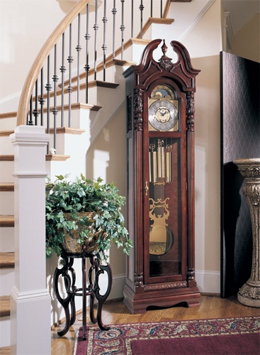 Something about grandfather clocks I've always loved!  I would like to have that staircase, too.. :)