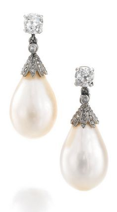 PAIR OF NATURAL PEARL AND DIAMOND PENDENT EAR CLIPS, LATE 19TH CENTURY Each set with a natural pearl drop measuring approximately 11.80 x 12.00 x 17.80 and 12.10 x 12.10 x 18.80mm, the surmounts set with circular-, single-cut and rose diamonds.