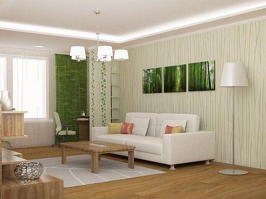 Гостиная-спальня радует своими весенними природными красками, сочетая в своем интерьере естественность дерева и изумрудные тона свежей листвы. Здесь несколько зон – рабочая и зона отдыха.  В зоне отдыха диван-кровать расположили напротив стенки с телевизором и витринным шкафом. Для хранения основной части гардероба хозяев квартиры в гостиной имеется большой платяной 4-дверный шкаф.  В каждой функциональной зоне – свое освещение, создающее удобство и комфорт.