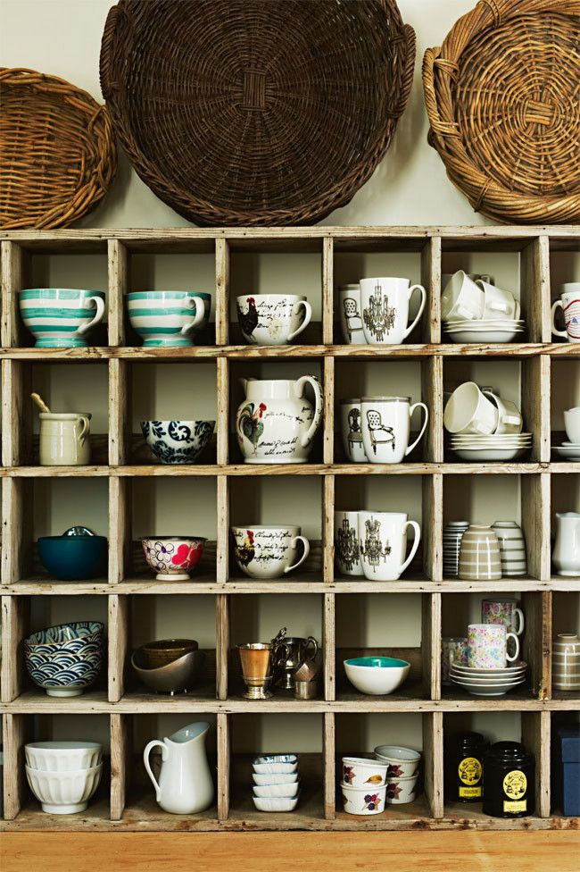 tea cups and wooden shelves - i'm not sure what happiness looks like, but i'm pretty sure it involves a wall like this