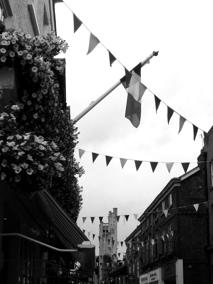 Hanging baskets and bunting, King Street, Knutsford, Cheshire.