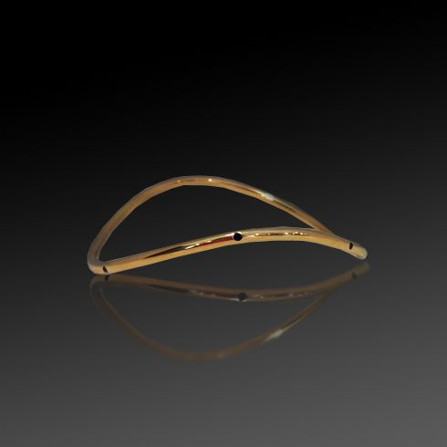 yellow gold wave bangle with gypsy set sapphires
