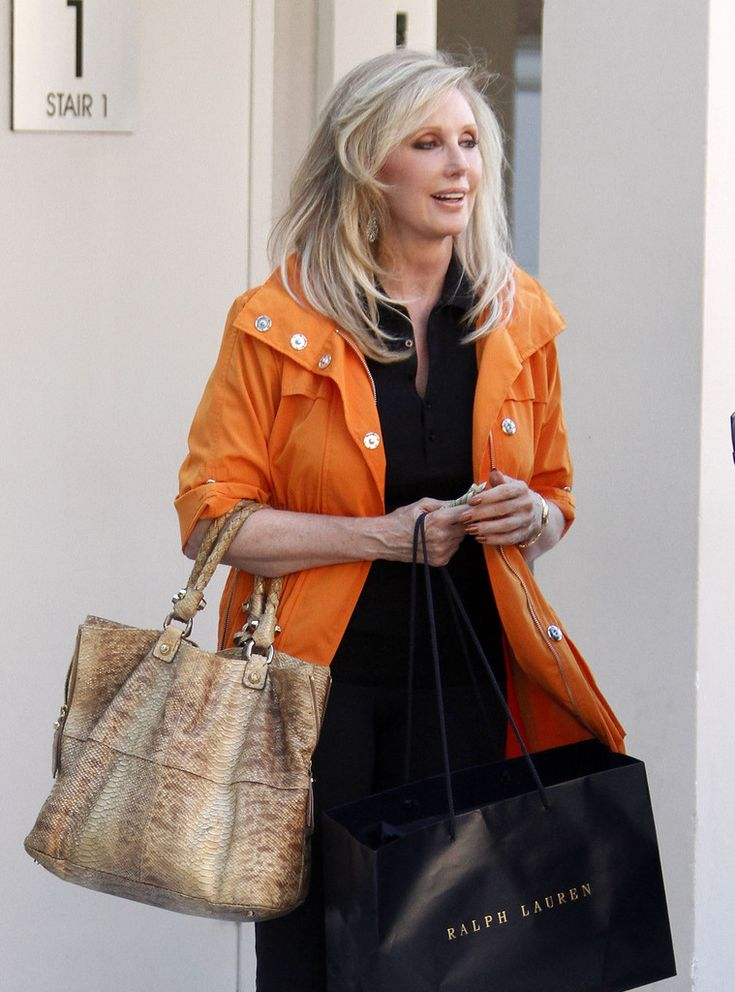 Actress Morgan Fairchild talks with friends while shopping in Beverly Hills.