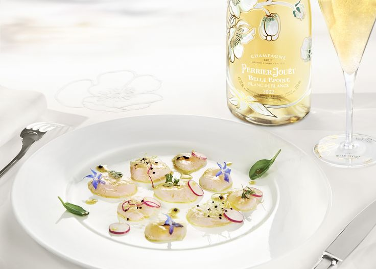 Begin your wedding dinner with the sensuality and delicacy of flower-garnished raw scallop islands, complimented by a flute of Perrier-Jouët Belle Epoque Blanc de Blancs 2002. #perrierjouet Please Drink Responsibly